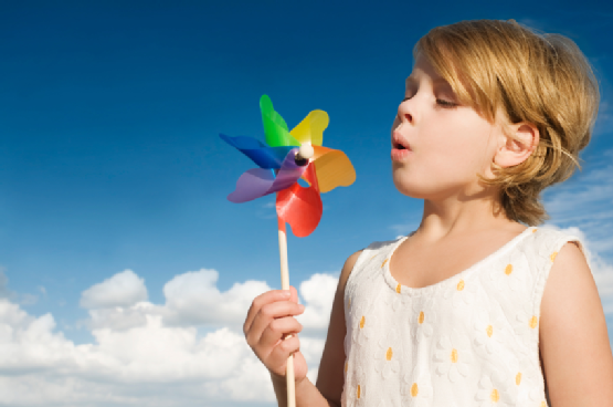 Girl blowing a pinwheel